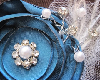 """Dark teal singed satin floral (3.5"""" stacked concentric circle flower) hair bow with pearl, rhinestone, tulle, feather, and netting accents"""