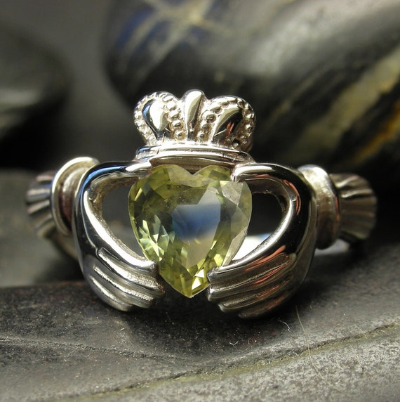 Customize your own claddagh ring with this unique two color sapphire in 10kt, 14kt or 18kt OOAK
