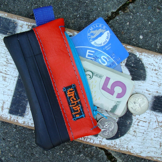 Eco friendly mini change purse wallet made from bicycle inner tube and scrap orange vinyl