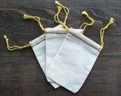100 2.75x4 inch Cotton Muslin Black Hem and Yellow Double Drawstring Bags