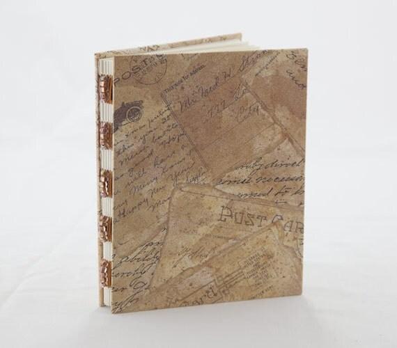Handmade journal with vintage postcard illustrations