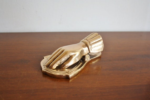 Vintage brass Hand office paper clip