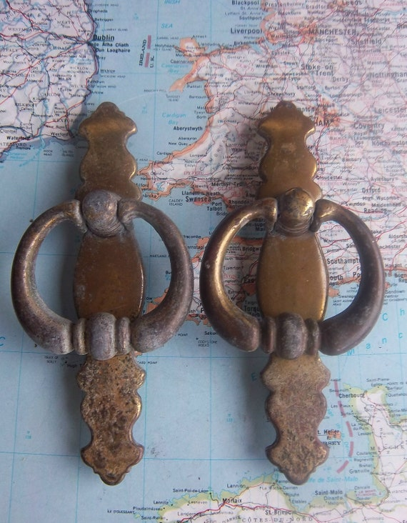 2 vintage open design brass metal pull handles with attached trimplates includes hardware