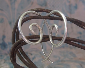 small silver spiral hoops