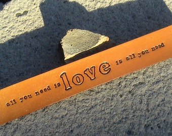 All you need is love - love is all you need, 1 inch wide leather wristband, lower case font