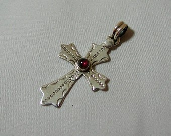 Sterling Silver Cross with Garnet Accent.