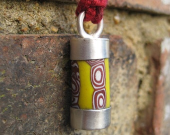 Sterling silver and antique Venetian millefiori African trade bead pendant. Small yellow/red pattern.