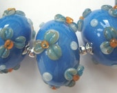Opal blue with raised flowers, hollow glass handmade lampwork beads SRA UK