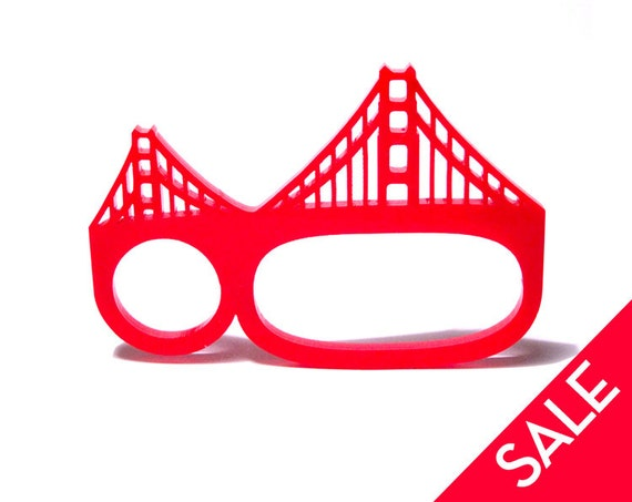 golden gate bridge three-finger brass knuckles acrylic ring