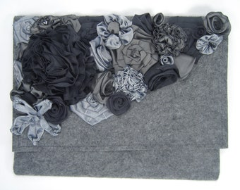 Gray clutch purse adorned with individually handmade ribbon roses and flowers