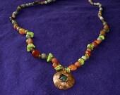 Beautiful coldset moss agate pod necklace