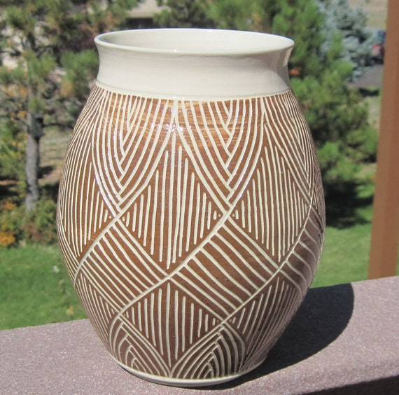Beautiful hand carved pottery vase visit shop for more