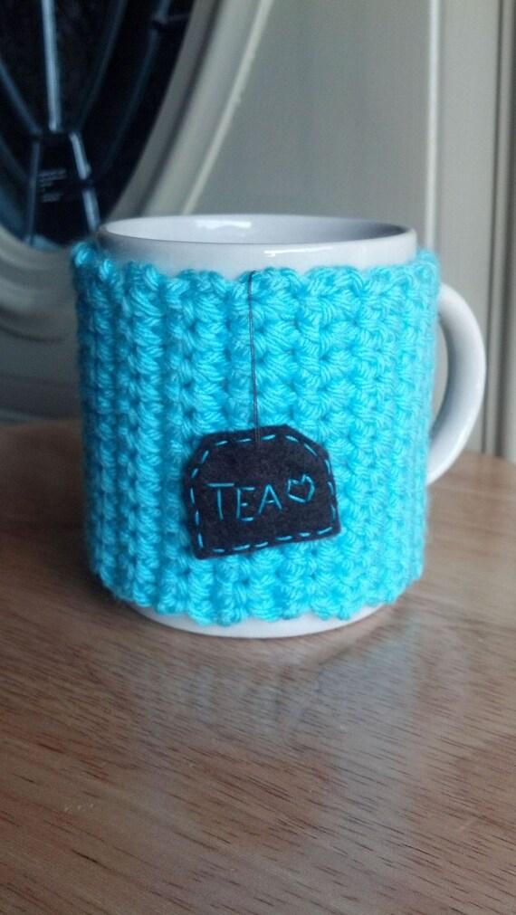 Crocheted tea mug cozy cup cozy in aqua blue aruba sea blue turquoise with hanging brown tea patch