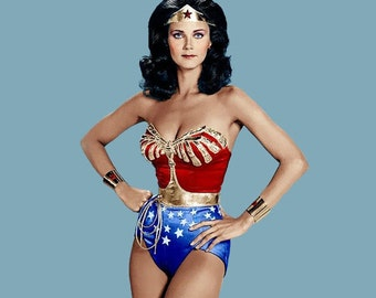 Full Wonder Woman Costume:  Corset, Tiara, Cuffs, Belt, Lasso, Choice Briefs or Shorts or Skirt (no cape)...
