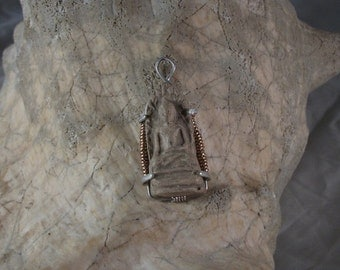 The Buddhist Amulet
