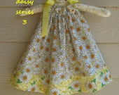 White Daisy Pillowcase Dress on a Yellow Background - 12 mth old -