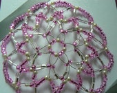 Clearance Kippah Sale!!!!Beaded kippah in shades of pink, pearls and clear glass czech beads.  Comes with a decorated gift box.