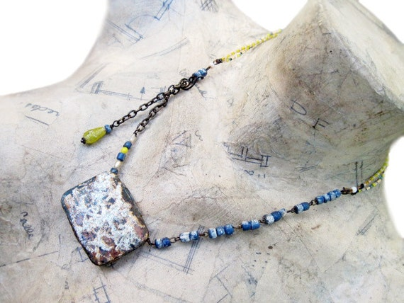 In a Little World. Rustic tin box with landscape assemblage necklace.