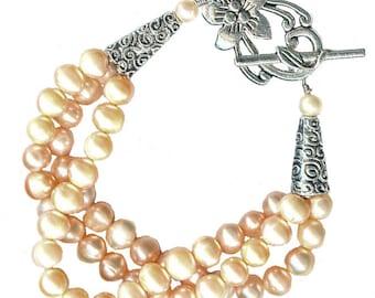 freshwater peach pearl three strand bracelet