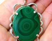 Dark green Malachite pendant with Victorian style frame in Sterling Silver.