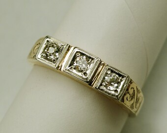 A 1940's 10k yellow gold and diamond three diamond band with hand-engraved design. (A1348)