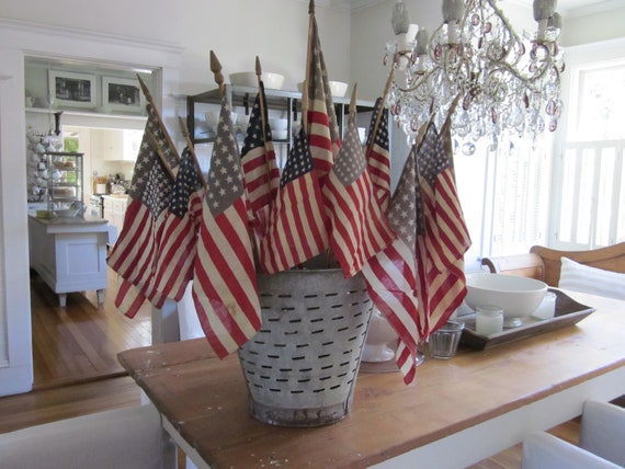 Thirteen antique American flags. 48 and 50 star 1912-1959