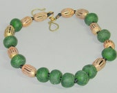 Necklace of bold, chunky glass and brass beads