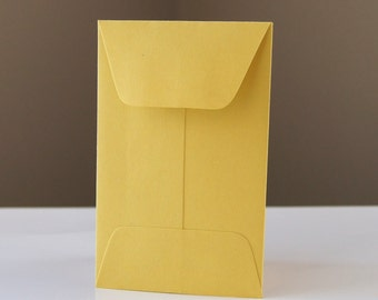 10 Open End Baby Envelopes in CURRY (yellow gold) .  2.25 x 3.5