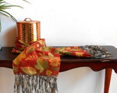 Red fleece scarf with autumn leaf print and grey green fringe
