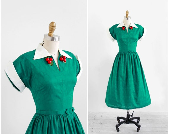 1940s or 1950s retro novelty dress with cherry neckline and green cotton