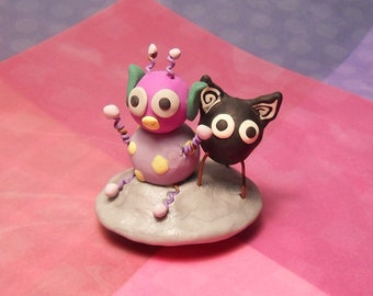 Handmade polymer clay UFO figurine two aliens sitting on a silver space ship saucer