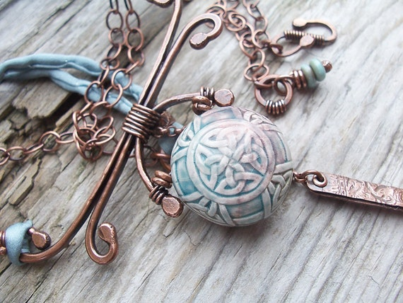 Chinese Porcelain Lentil Pendant with Copper Pagoda Metalwork and Teal Silk