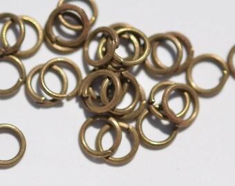 100 Antique Bronze Tone 7mm Jump Rings F110