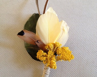 Golden Yarrow Grooms Boutonniere with Feathers and a real leaf