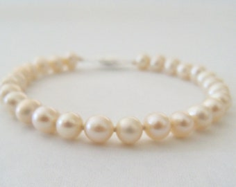 light blush freshwater pearl bracelet 6mm lightly oval shaped, hand knotted with 925 sterling filigree clasp