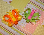 Clippycabin butterfly girl hair clips.. Set of 2 Orange Green