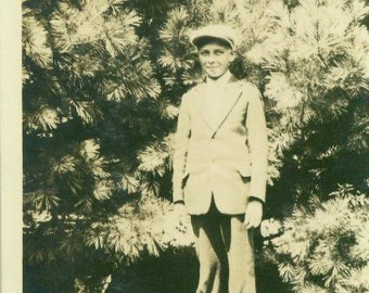 Leo Esser 1930s Boy in Suit and Hat Standing In Front of Pine Trees Vintage Photo Photograph