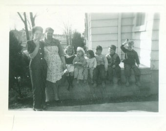 1946 Family Mom Smoking Cigarette Grandma in Apron Kids Sitting on A Wall 40s  Vintage Photo Black and White Photograph