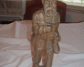 vintage wooden hand carved figure of old man with back pack