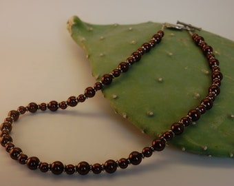 Brown glass pearl necklace with love bird toggle