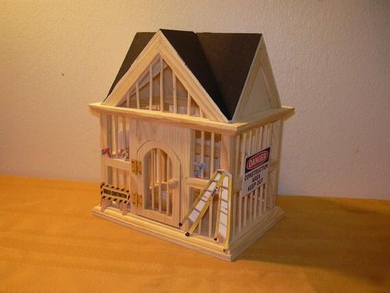 """Miniature """"Under Construction"""" house"""