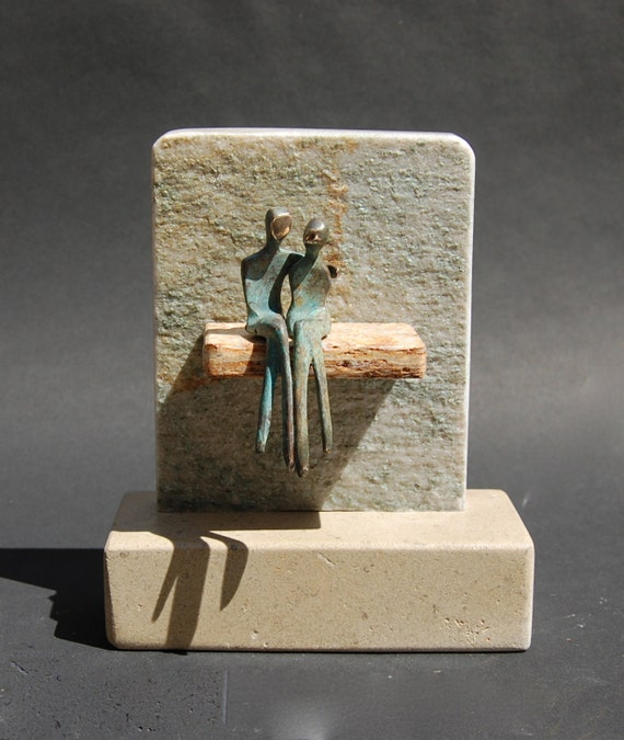 Miniature love couple sculpture, him holding her,  with base
