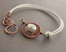 White leather copper bracelet with white Swarovski drop pearl and swan hook clasp