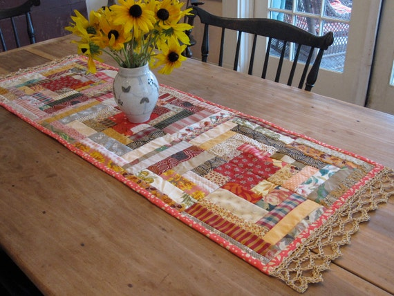 quilted folk table runner in log cabin patchwork from treasured scraps with hand crochet edge