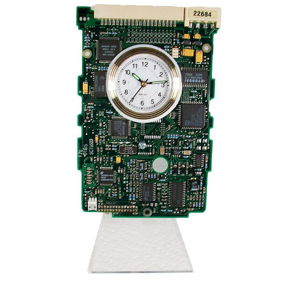 here is a circuit board alarm clock from recycled by tecoart