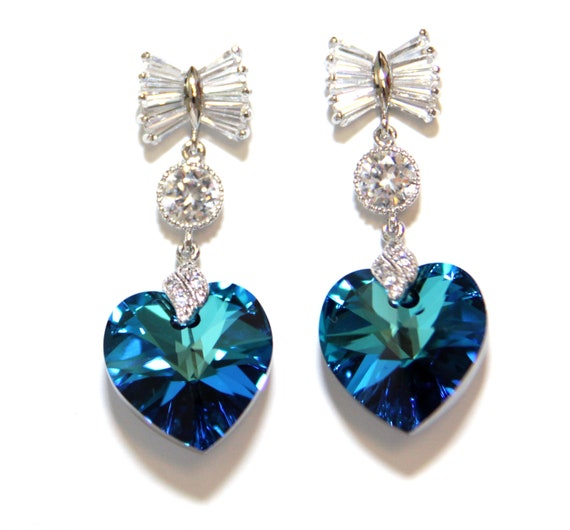 items similar to bow earrings with bermuda blue
