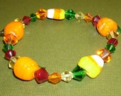 Halloween and Fall Beaded Bracelet with Pumpkins, Candy Corn, and Colorful glass beads