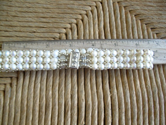 Beautiful Bridal choker featuring a stretch choker with Rhinestone silver tone clasp and Genuine pearls