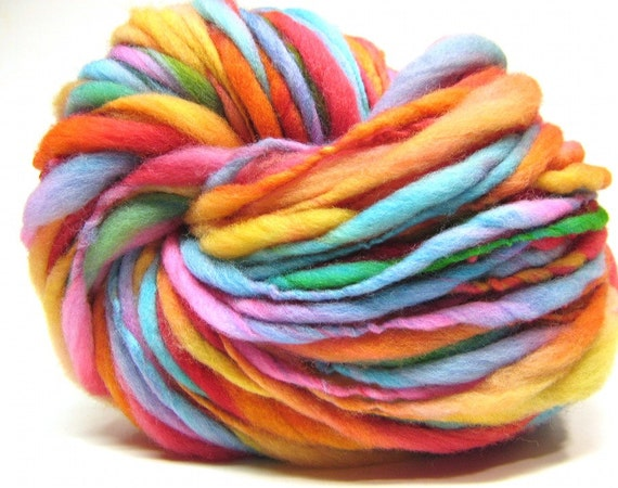 Super bulky handspun rainbow yarn, spun thick and thin in merino wool- 100 yards, 3.15 ounces/ 90 grams