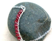 faceted ruby necklace with hand formed and hammered recycled sterling silver- 'ellipse'